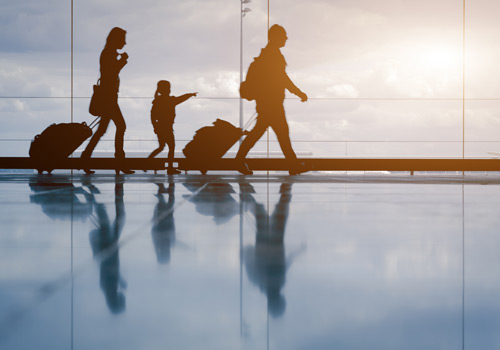 travelers walking in airport