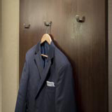 warwick rittenhouse suit hanging by closet